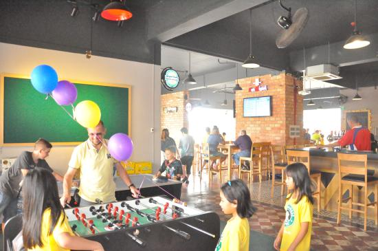 pitchers sports and grill kids playing table soccer - Pitchers For Kids