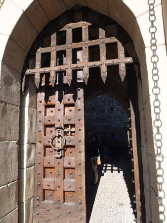 Castello di Amorosa Portcullis and iron-studded door guarding guest entryway & Portcullis and iron-studded door guarding guest entryway - Picture ...