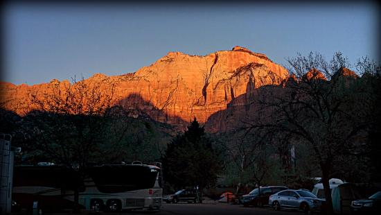 Zion Canyon Campground: Westerly view of sunrise from campsite (R23)