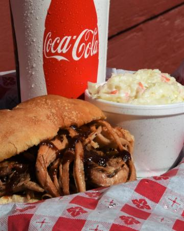 Nebraska City, NE: Pulled Pork Sandwich, sides include choice of potato salad, coleslaw, fries or baked beans