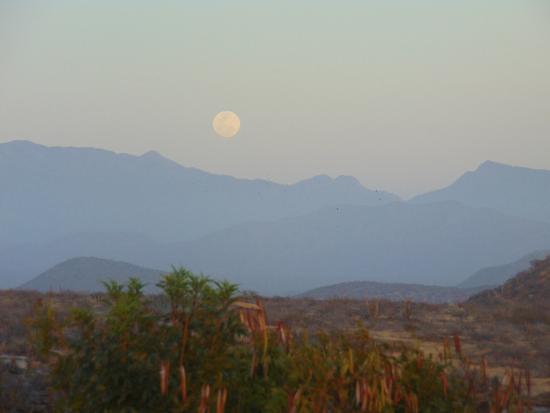Todos Santos, Mexico: At El Mirador as full moon rises over distant Sierra La Laguna Mountains