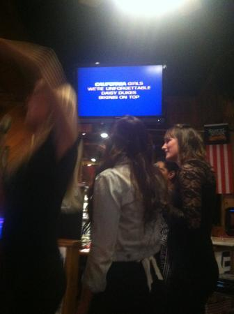 Cheers Good Time Saloons: Trio singing next to our table