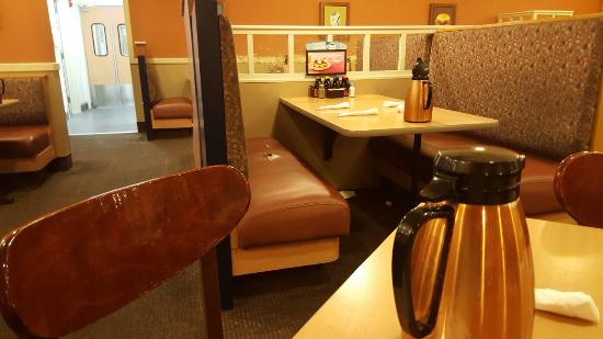 IHOP: Here Is A Booth With A Torn Cushion And Trash Under The Table