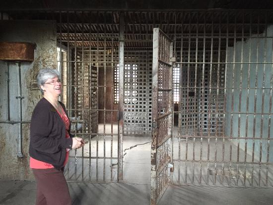 Gonzales, TX: docent showing jail cells