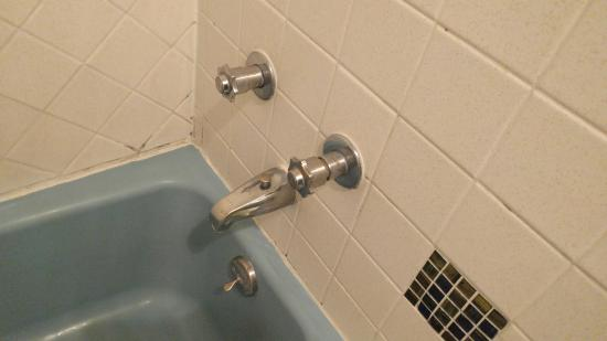 Grand Junction, CO: Mildew and old fixtures in tub.
