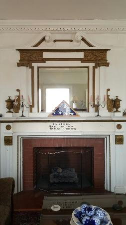 The Yellow Room, mantelpiece with medals in the main living room, Kane Manor in sunshine and Kan