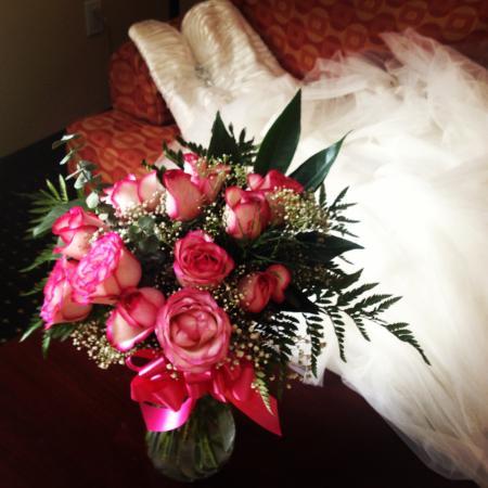 Fairfield Inn & Suites Texarkana: My dress & flowers on the couch in the hotel room!