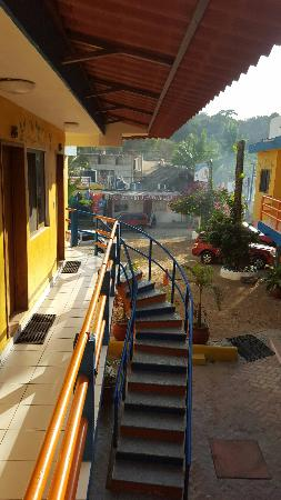 Las Brisas Hotel - Restaurant - Bar: Parking lot and stairs to rooms