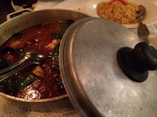 "Cranston, RI: ""Mariscada Spain"" entree with a side of saffron rice"