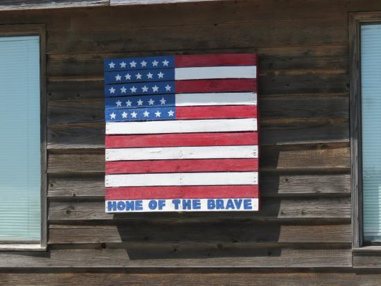 General McArthur's: Flag on the side of the building