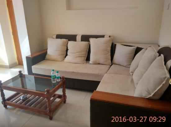 Entry Room With Lshaped Sofa And Two Chairs And Center Table - Coffee table for l shaped sofa