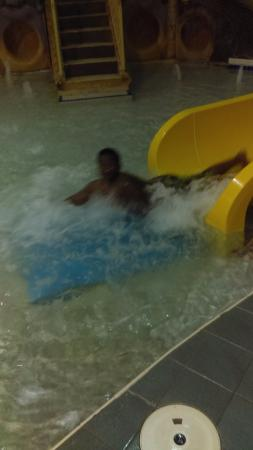 Alakai Hotel and Suites: My Grandson enjoying the slide.