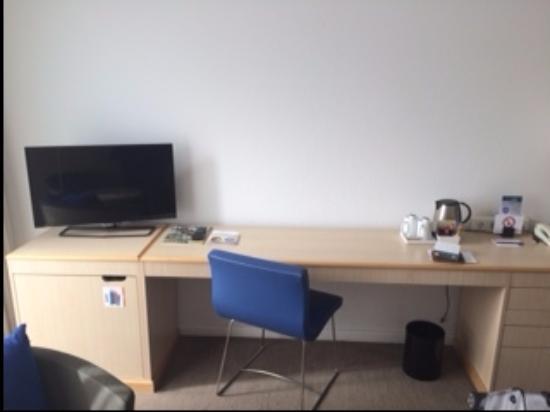 large desk area minibar under the tv picture of novotel berlin rh tripadvisor com