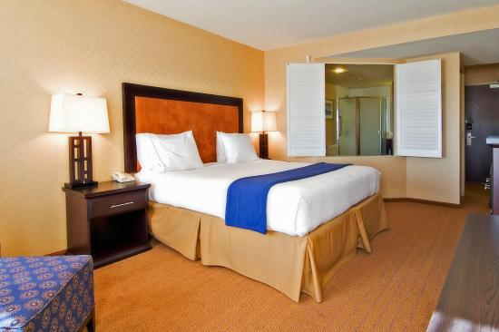 Holiday Inn Express Hotel & Suites Riverport: King Bed Spa Suite With Separate Shower, TV,  Microwave & Fridge.