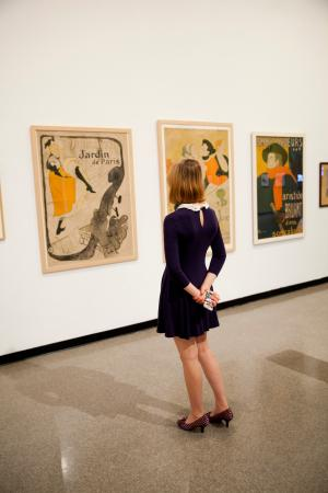 A visitor glances at a work of art at the Arlington Museum of Art.