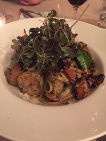 Boland's Open Kitchen: Jump-fried shrimp linguini in a basil-cashew pesto with olives, tomatoes and butternut squash