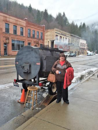 SmokeHouse BBQ & Saloon: This is my wife standing in front of the smoker..