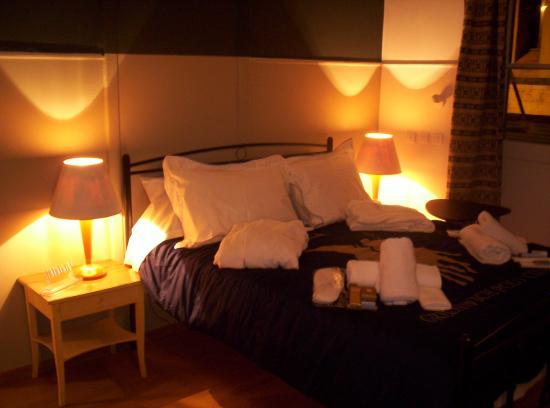 Queen Bed , Amenities with Bathrobes. \
