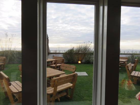 Prestwick, UK: view out of bar with outside seating