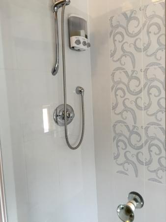Pembridge, UK: another of our shower rooms re-tiled all over