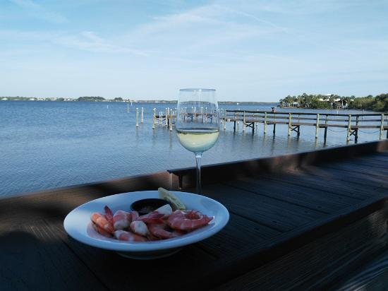 Rockledge, FL: Shrimp cocktail, white wine and this view.