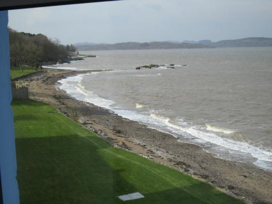 Auchencairn, UK: High tide but still room to walk a dog either on the beach or on the hotel's grass