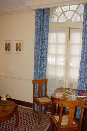 Hotel La Casona: Living Room game table with wooden shoe decor on wall.