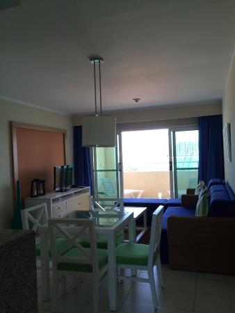 dining area and living area with television and a balcony picture rh tripadvisor co za