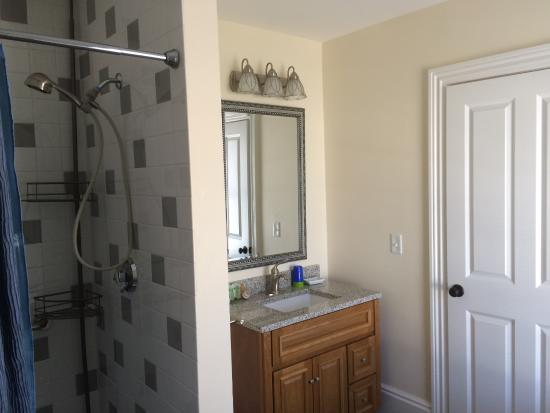 Somerville, MA: ensuite bathroom with shower and tub and sink