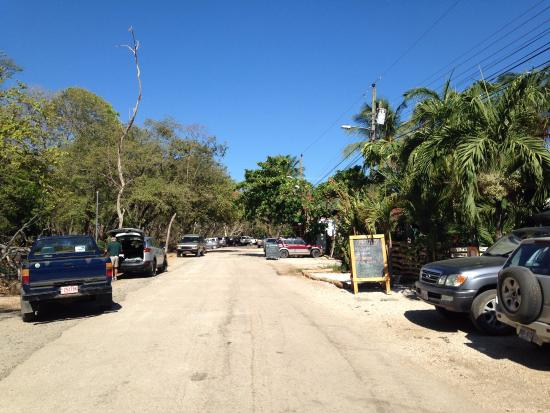 Playa Grande, Costa Rica: Sugar's Monkey is on the right by the sign. At the end of this road is the beautiful beach.