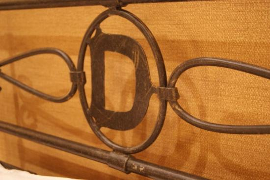 """The Driskill """"D"""" that is everywhere around the hotel. This was the iron headboard in our room."""