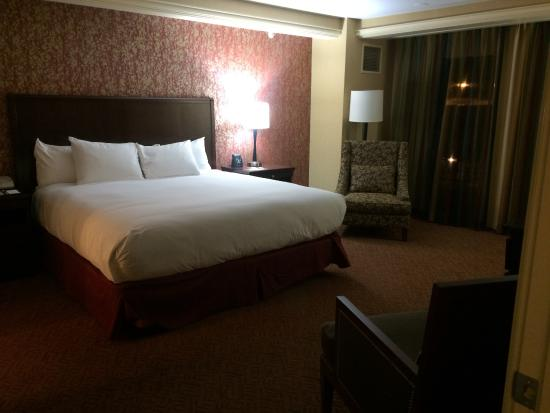 large bed with sliding glass doors to balcony and view of mountains rh tripadvisor co nz