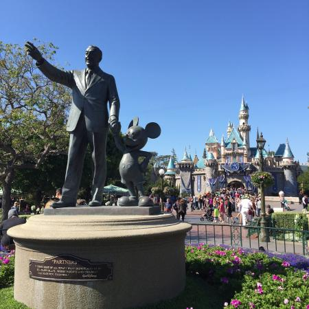 The Iconic Sleeping Beauty Castle And Walt Disney Statue Picture