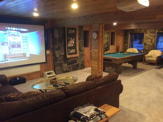The downstairs rec room with projection tv pool table and for Rec room pools