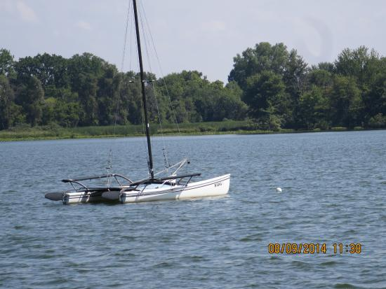 Kendallville, IN: A sailboat anchored on the lake and the East side of the lake