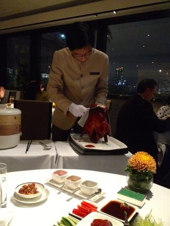 Carving pre-ordered Peking Duck at the table