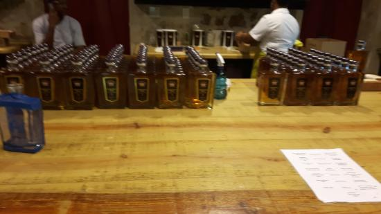 Saint Peter Parish, Barbados: Bottling of St Nicholas Abbey rum with labels manually applied.
