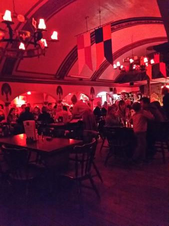 Newlyn, UK: The hall is decorated in a King Arthur Theme.The red lighting makes it hard to make out