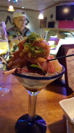Carbondale, CO: A Yellowtail poki appetizer with owner Willie in the back, keeping everyone entertained as they