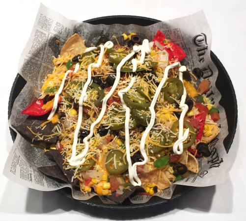 Volcano Nachos at Features West Salem