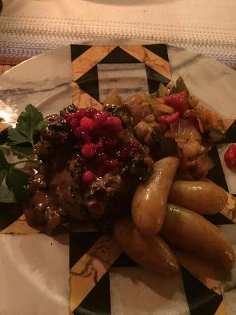 "Knappgarden Pension & Restaurant: Brown Bear & Reindeer ""meatloaf"" with fingerling potatoes and lingonberries."