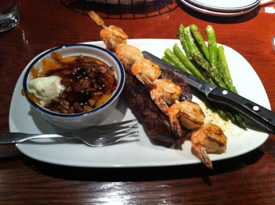 Cuyahoga Falls, OH: the steak and shrimp , sides of sweet potato and asparagus