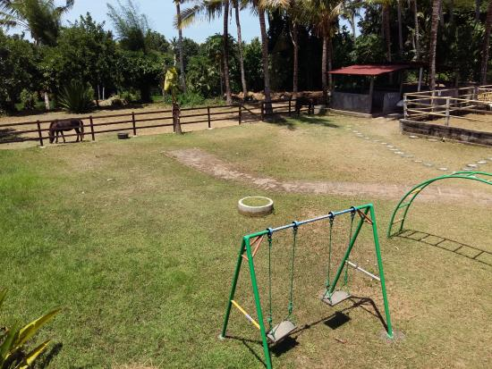 Mandala Desa: Children's play area and horse paddock at the rear of the boutique resort