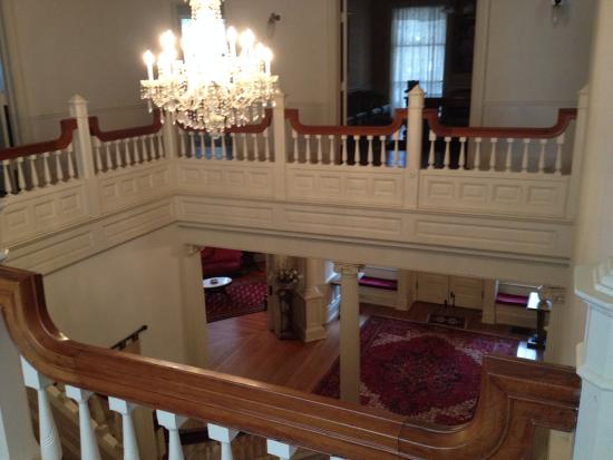 the cresent view from top of stairs down on front door area rh tripadvisor com