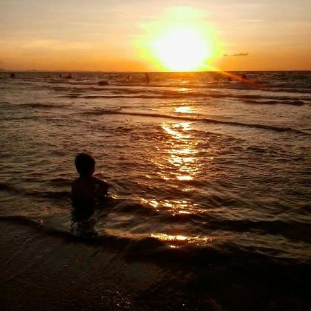 At tondaligan beach... my son and the sunset
