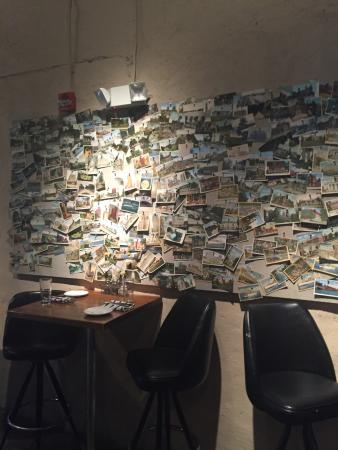Local Kitchen and Bar : Picture of restaurant from the bar and a wall full of postcards.