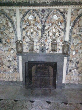 The Cilwendeg Shell House Hermitage: This is the fire place and as you can see the wall surrounding is covered in shells