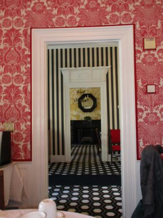 The Cooper Inn: At breakfast, I noticed the three wallpapered rooms observable through 2 doorways.