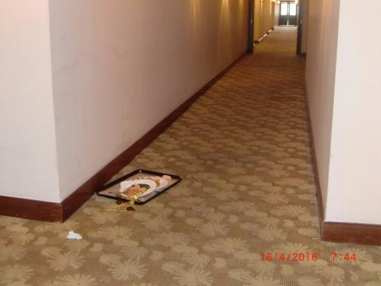Sri Kembangan, Malaysia: Uneaten meals left in hallway with food on the carpet.