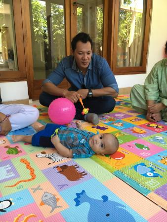 Bali Island Adventure Tour : We went to an orphanage. Gede didn't just wait for us outside, he played with the babies too!